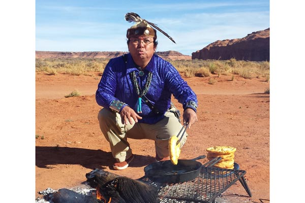 Navajo man cooking frybread on Goulding's Tour