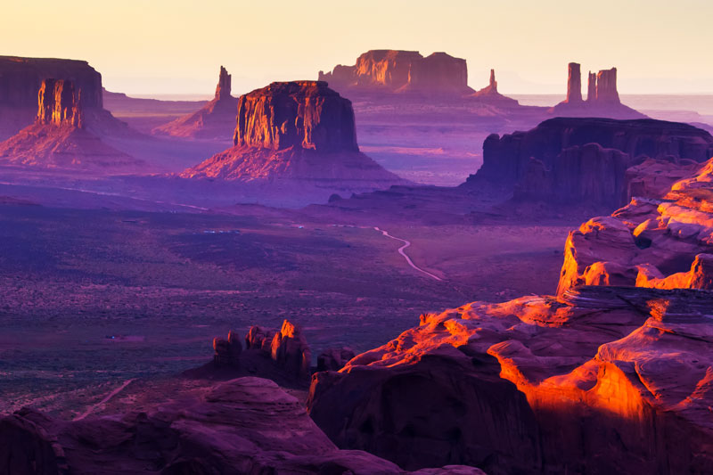 Monument Valley at Sunset casting a purple haze